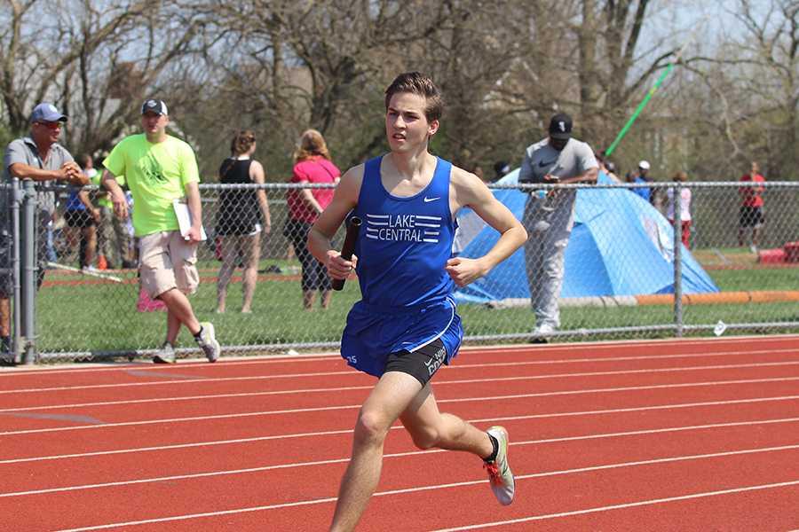 Andrew Ackerman (12) turns onto the third turn on the track. Ackerman ran the boys 4X800 meter relay.