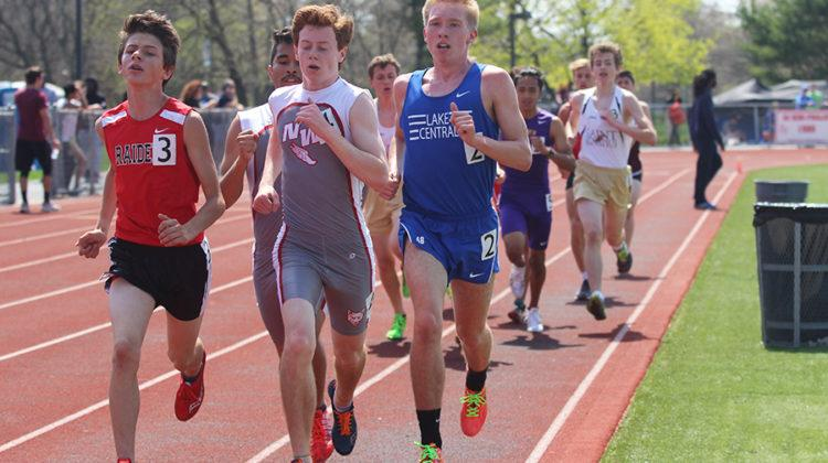 Joseph Copeland (12) moves down the track while running the boys 3200 meter. Copeland ran a 1600 meter dash.