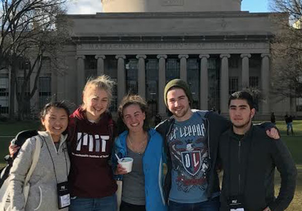 Mohammed Hijaz (12, far right) poses with friends in front of his future college. Hijaz was one out of 1,511 applicants accepted into Massachusetts Institute of Technology.