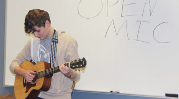 Mason Crawford (11) starts off the club by breaking the ice and playing a song on his guitar. Crawford ran the Open Mic club this year on Thursdays after school.