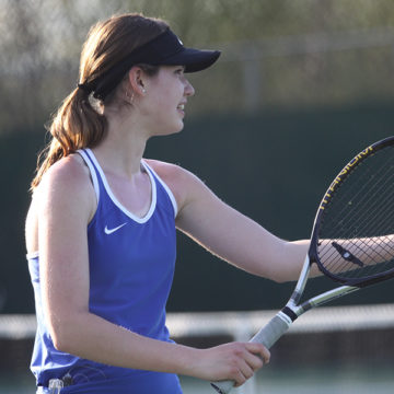 Colette Oboy (11) gets ready to serve during her tennis match. The girls tennis match was on April 17 at home.