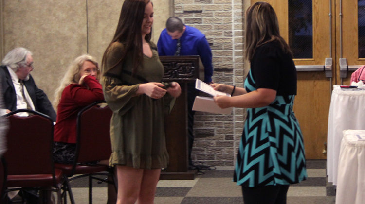 Marissa Denys (10) receives her certificate. The banquet lasted an hour and a half.