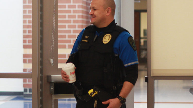 Officer Jerry Patrick smiles as he walks through the door. The breakfast was offered to  Dyer, Schererville and St. John police chiefs, fire chiefs, principals, vice principals and deans.