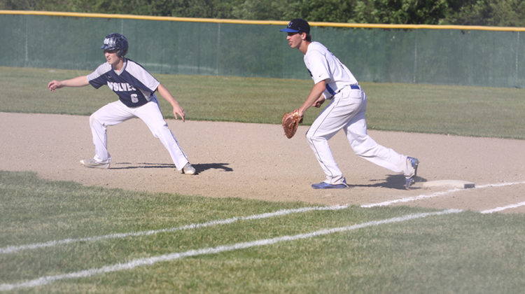 Jack Hilvert (10) tags first base with his right foot. Hilvert prepared to touch the runner if he tried to steal a base.