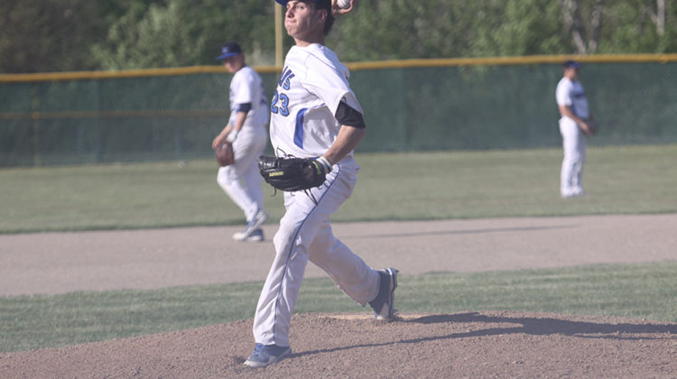 Maxwell Born (10) puffs his cheeks while beginning to throw a pitch. Born's pitching was very beneficial to the team.