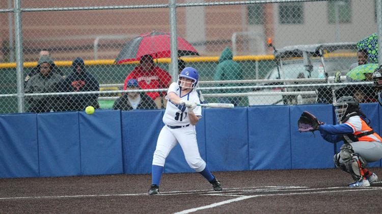 Jenna Towle (10) has her eye on the ball as she prepares to swing. The varsity softball team won 10-0.