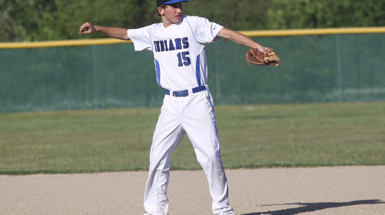 Jack Hilvert (10) throws a rock off the field to keep it from conflicting with the game. This was the Indians last home game of the season.