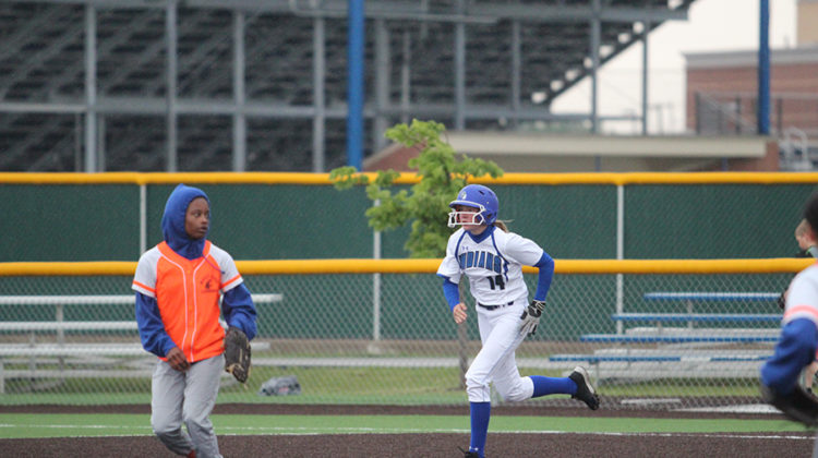 Olivia Peterson (10) sprints to second base through the rain. The game was rained out part way through, so the teams continued the game on May 25.