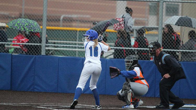 Cheyenne Mathas (11) resists the urge to swing, as the ball comes flying toward her. As she was batting, her teammates showed their support by cheering her on.