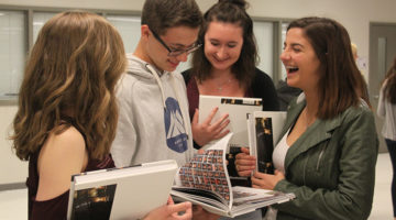 "A group of sophomores laugh as they look through the yearbook. The theme of this years book was ""What's the Big Deal?"""