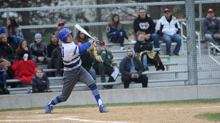 Jarrett Lopez (12) swings the bat attempting to hit the ball. Lake Central lost to Munster in last years sectionals.