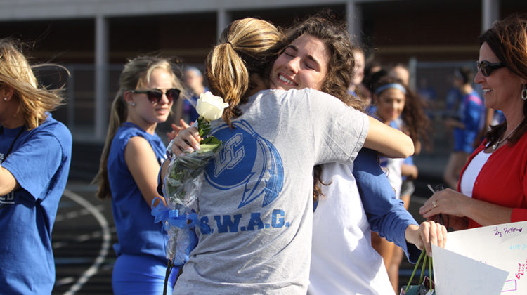 Ellie Keith (12) hugs her coach in a sentimental moment. Keith ran track and cross country for Lake Central.