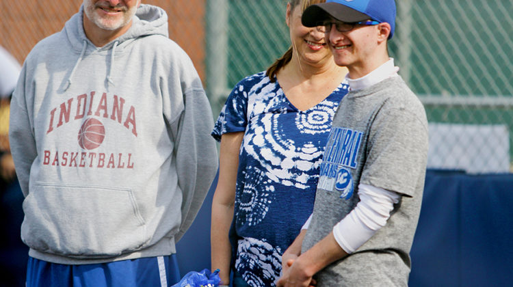 Nick Rossi (12) smiles as he is honored before the Varsity Softball game.
