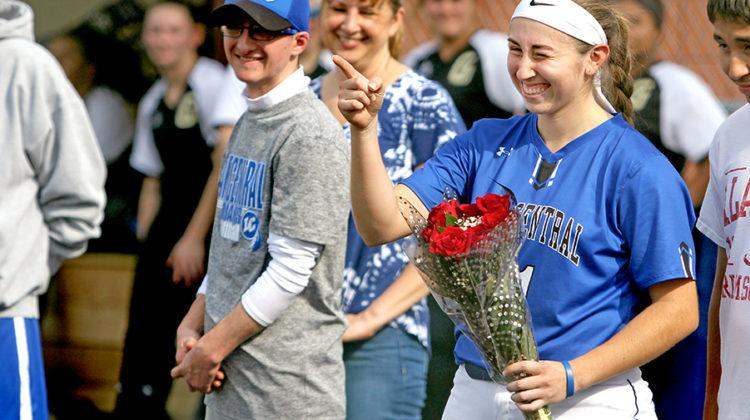 Cristal Guzman (12) winks after being handed flowers. Guzman was being honored before her last game.