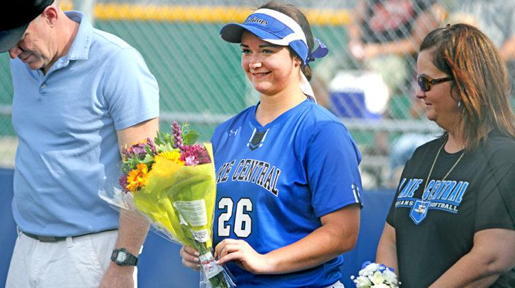 Alex Hickey (12) smiles after being handed flowers. LC won with the final score of 11-0.