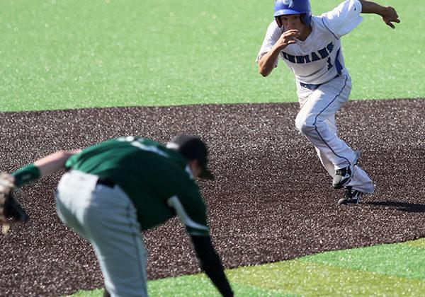 Jake Dykstra (10) attempts to beat his opponent to third base. Dykstra scored two runs during the game.