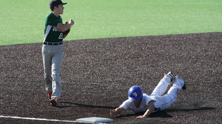 Jake Dykstra (10) slides head-first into third base, beating Illiana's third baseman there. The baseball team's senior night is on March 19.