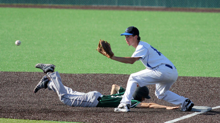 Jack Hilvert (10) extends his arm to catch the ball and to tag his opponent out. Hilvert plays first base for his team.