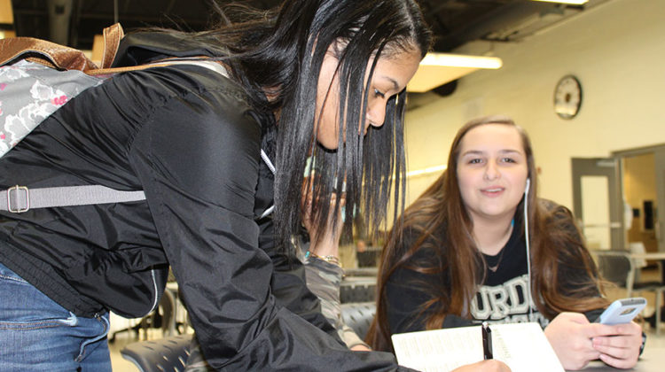 Aniyah Thompkins (9) writes her  name on the sign-in sheet. The members of the cabinet discussed freshman rush and lanyard sales.