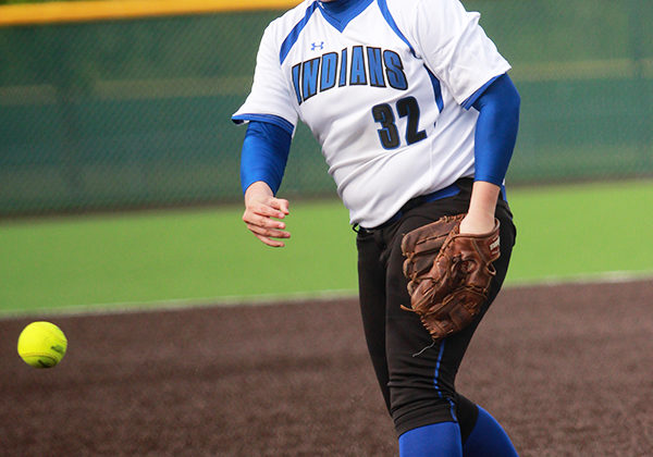 Selena Michka (11) pitches the ball for the Indians. Michka had eight strikeouts during the game.