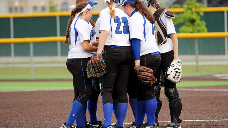 The infield gathers for a talk before the start of the inning. Lake Central went on to beat Laporte 2-1.
