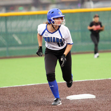 Amanda Noblett (11) pinch runs for Selena Michka (11). The Lake Central Indian's played The Laporte Slicers.