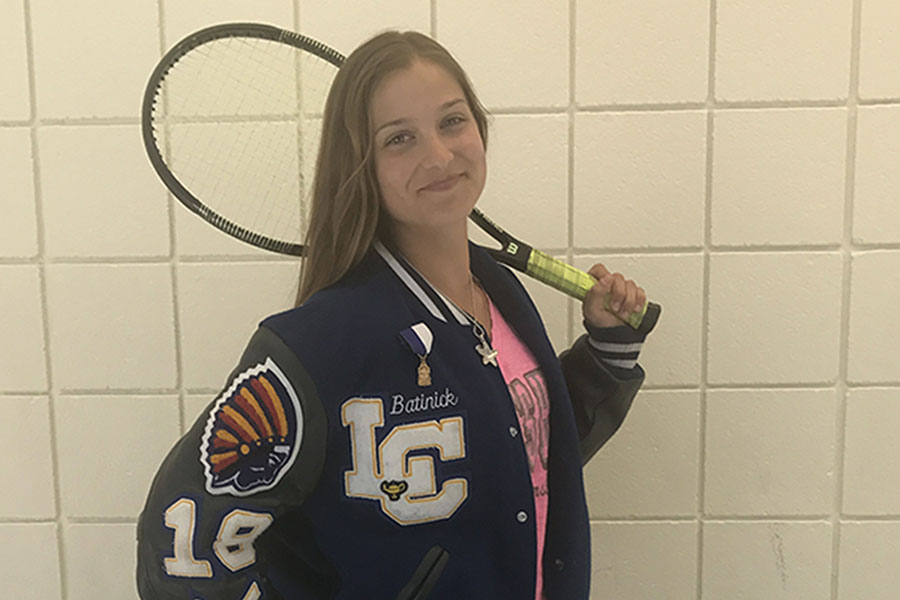 Sydney Batnick(11) poses with her tennis equipment. She  attended one of her last practices of the season.