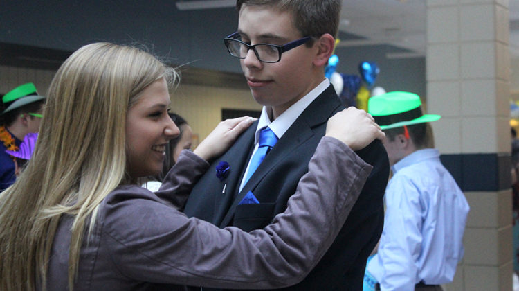 Austin Huber (12) dances with Anna Weir (11) during the slow dance. The club met at least once a month to participate in fun activities outside of school.