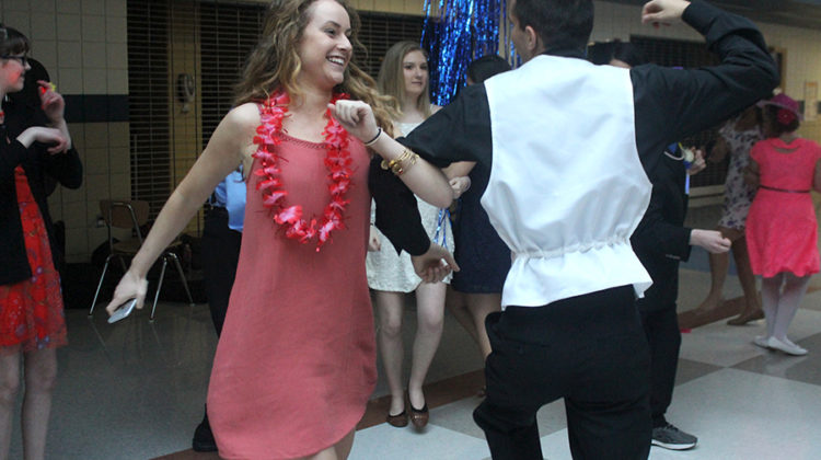 "Christian Huber (12) skips with Elly Gross (11) to ""The Chicken Dance."" Parents and teachers were welcome to join the dance floor."