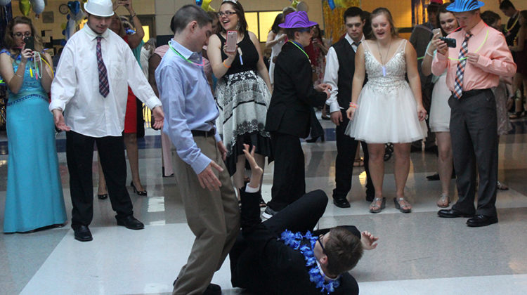 Students gather in a dance circle around  Austin Huber (12) and Nick Rossi (12). Best buddies held this dance every year.