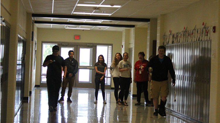 The French club members gather in the hallway outside of Beverly Bovard's, World Language, classroom. They began the relay race two at a time.