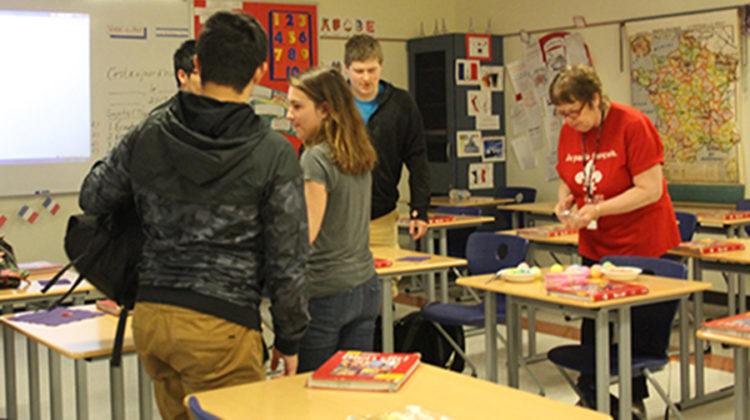 Beverly Bovard, World Language, explains the directions of the game to the club members. They each grabbed a plastic Easter egg and headed out into the hallway.