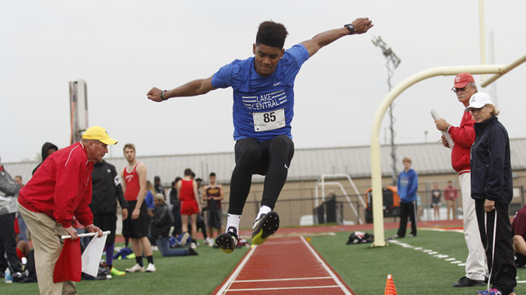 Keon Sellers (11) leaps in the air for his second jump in the long jump event. Many of the field events like long jump brought in a large amount of points for the whole team.