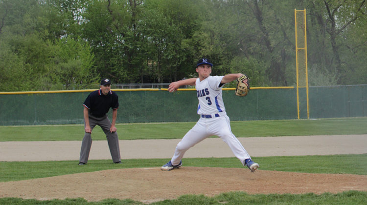 Ian Lukowski (10) pitches the ball in a game against Merrillville.  The Indians JV team won this game 24-5.