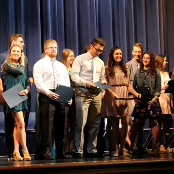 Students gather on stage to receive their James & Betty Dye Foundation scholarship award. This was the first of many scholarships awarded that night.