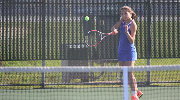 Danica Mileusnic (10) swings at the ball to try to beat her opponent. Mileusnic ended up losing with a score of 1 to 2.