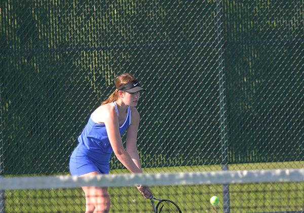 Colette Oboy (11) retrieves the ball and hits it back to her opponent. Oboy won her game with scores of 7-5 and 6-1.