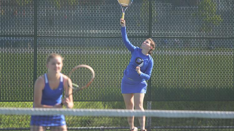 Anna Wachowski (12) serves the ball during her doubles match against Valparaiso. Wachowski and her partner, Claire Gronek (11), won two out of three sets.
