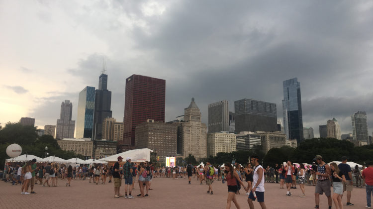 Lollapalooza goers waiting for rain to pass by the fountain. Grant Park was evacuated on Thursday, August 3rd.