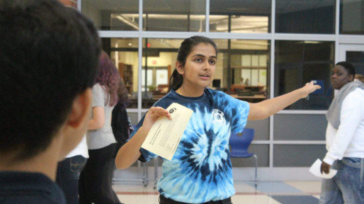 Sneha Shatish (12) gives her tour group directions. Shatish was giving tours as part of the new peer mentorship program.