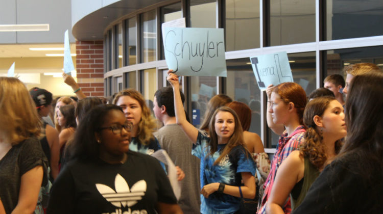 Rachel Eder (12) searches for her group in the sea of new students. At the start of the rush, each mentor stood with signs of a PTE teacher's names to easily assemble groups.