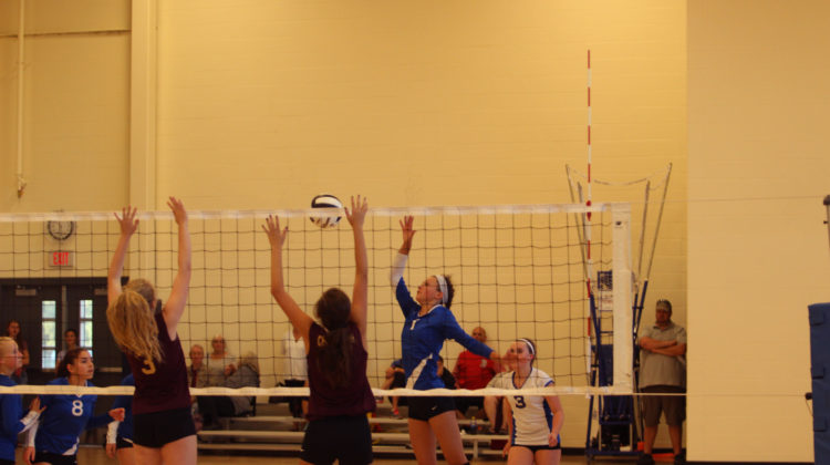 Katharine Mahoney (9) is setting up another teammate for a spike.  She played the outside position during the game.
