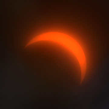 The eclipse at 90 percent totality. The solar eclipse could be viewed safely through Mr. Bushong's filtered telescope.