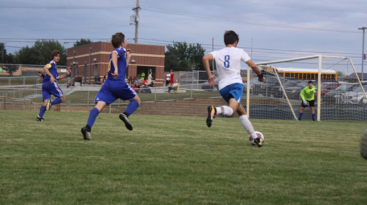Carson Shrader (11) controls the ball. Shrader played a big role in the game against Highland.