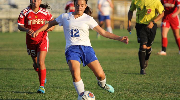 Veronica Ruiz-Avila (9) kicks the ball toward Andrean's goal. This is Ruiz-Avila's first year on JV.
