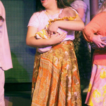 """Ava Solis (10) in the musical """"Once on this Island"""". She was singing during the opening. Photo By: Olivia Throckmartin"""