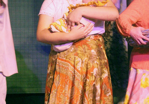 "Ava Solis (10) in the musical ""Once on this Island"". She was singing during the opening. Photo By: Olivia Throckmartin"