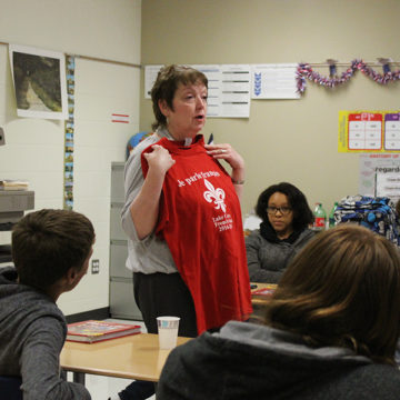 Ms. Beverly Bovard, World Language, explains how to purchase French Club shirts. The first French Club meeting of this year was held on Tuesday, Sept. 12.