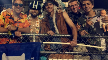 The LC Fan Section supports the Tribe as they play against Portage High School. The theme was Hawaiian.