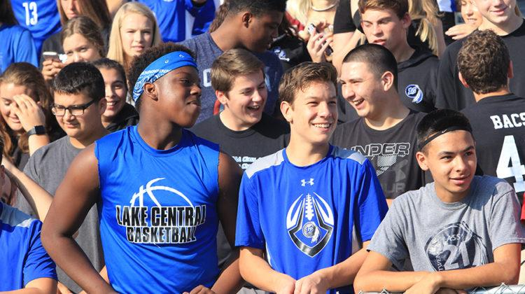:  Three freshmen stand up during the pep rally. This is Lake Central's third fall pep rally.